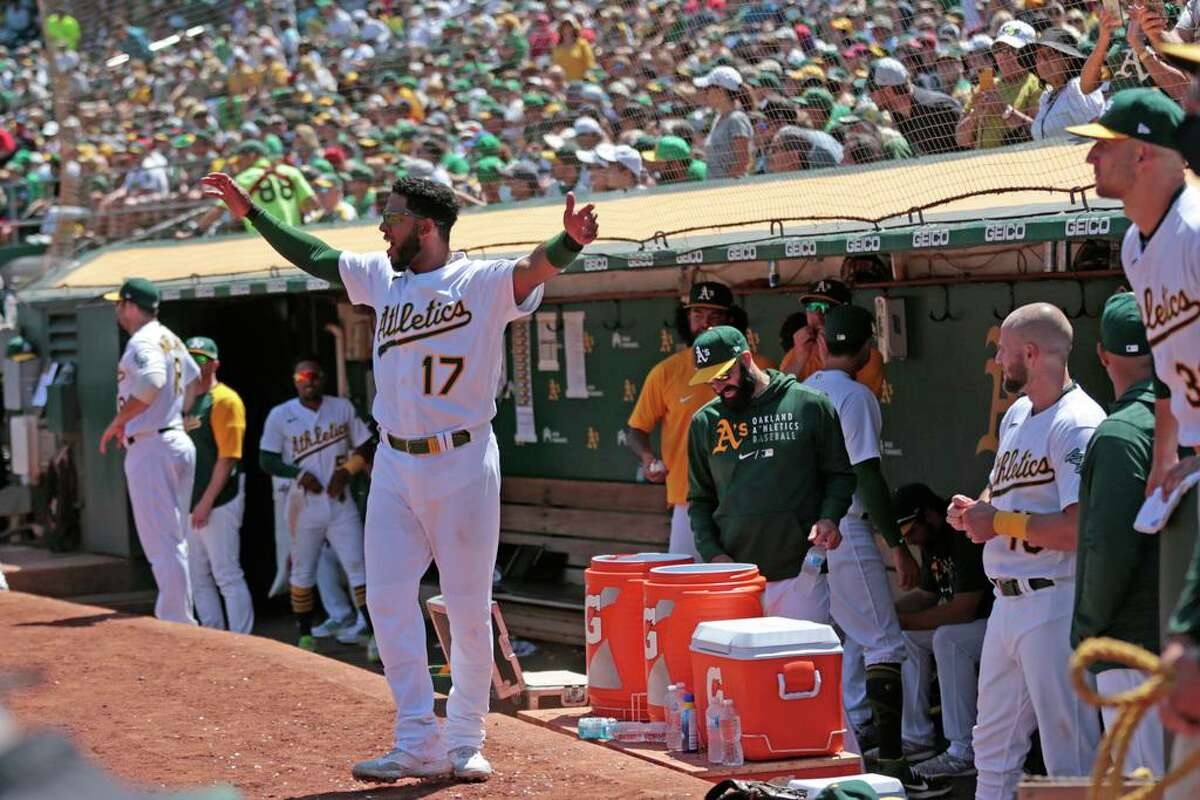 Oakland Athletics Elvis Andrus (17) cheers in the sixth during an MLB game against the Los Angeles Angels at RingCentral Coliseum on Tuesday, July 20, 2021, in Oakland, Calif.