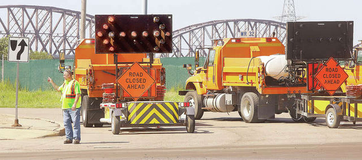 FILE - Illinois Department of Transportation workers closed the entrance to the McKinley Bridge, background, following two incidents on the bridge.