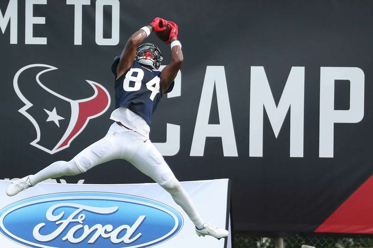 Houston Texans wide receiver Jordan Veasy leaps to make a catch during an NFL training camp football practice Wednesday, Aug. 4, 2021, in Houston.