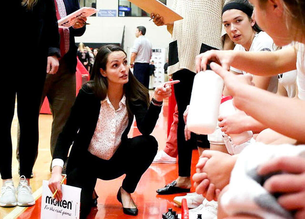 SIUE volleyball coach Kendall Paulus, center, gives her team instructions last season. SIUE will open its season Aug. 21 when the Cougars play host to SIU Carbondale in an exhibition match..