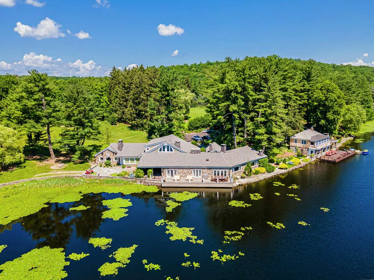 The property, listed by Corcoran Country Living for nearly $20 million, boasts 164 acres with a private lake, main residence and several outbuildings.