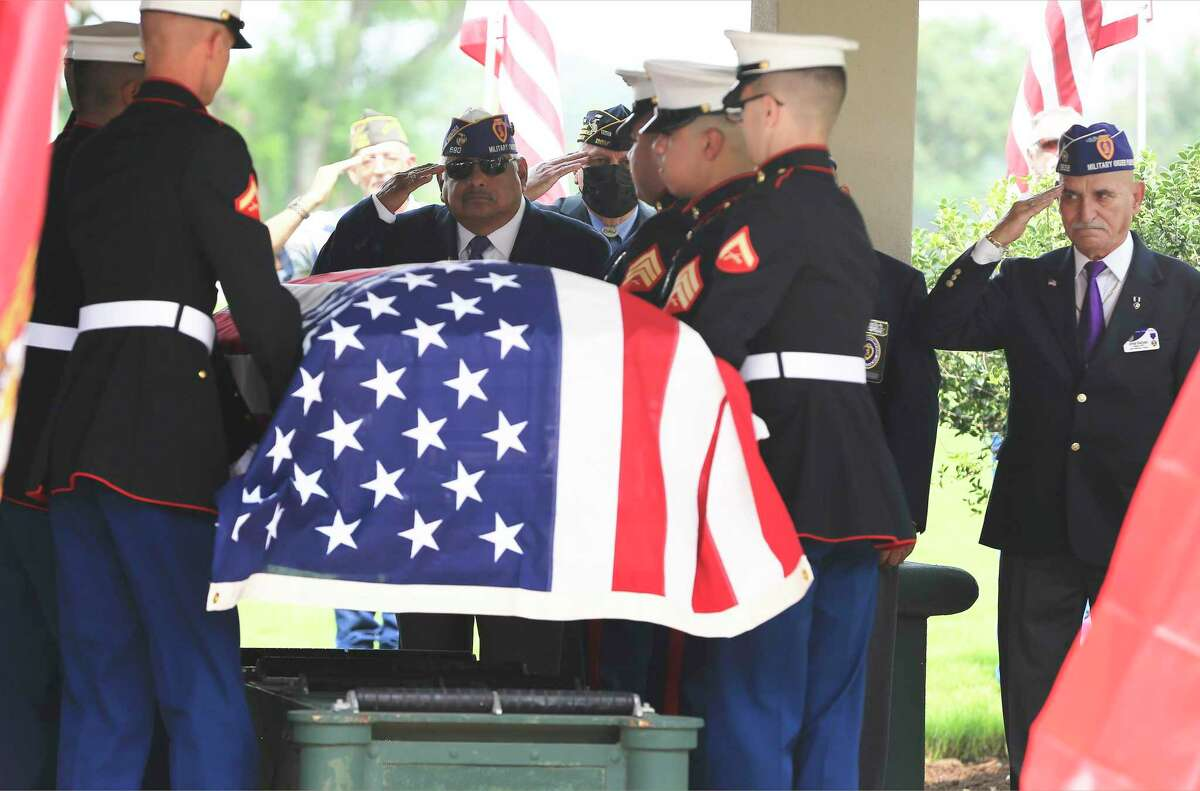 Veterans salute the flag-draped casket of Marine Pfc. J.L. Hancock during a funeral service at Fort Sam Houston National Cemetery on Wednesday. He served in the 2nd Marine Division and was killed during the bitter fighting for the small island of Betio in the Tarawa Atoll of the Gilbert Islands on Nov. 22, 1943. The Defense POW/MIA Accounting Agency identified the remains of Hancock, 21, who grew up in the Texas Panhandle town of McLean.