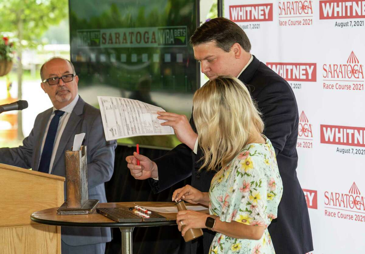 Handicapper Andy Serling, left, emcees the post position draw for the Whitney Stakes, held in the Marylou Whitney Pavilion at Saratoga Race Course on Wednesday.