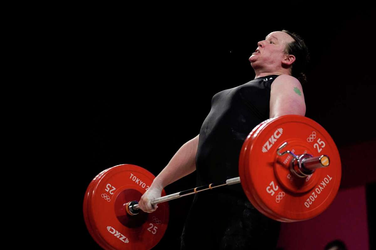 Laurel Hubbard of New Zealand competes in the women's +87kg weightlifting eventat the 2020 Summer Olympics, Monday, Aug. 2, 2021, in Tokyo, Japan. (AP Photo/Seth Wenig)