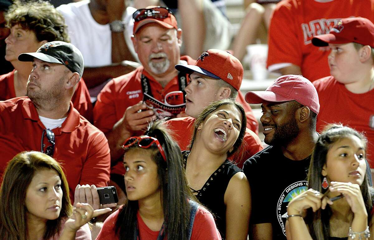 Lamar's fans joke with one another as they take in the game action with Nicholls State during their match-up Saturday at Provost - Umphrey Stadium. Photo taken Saturday, September 30, 2017 Kim Brent/The Enterprise
