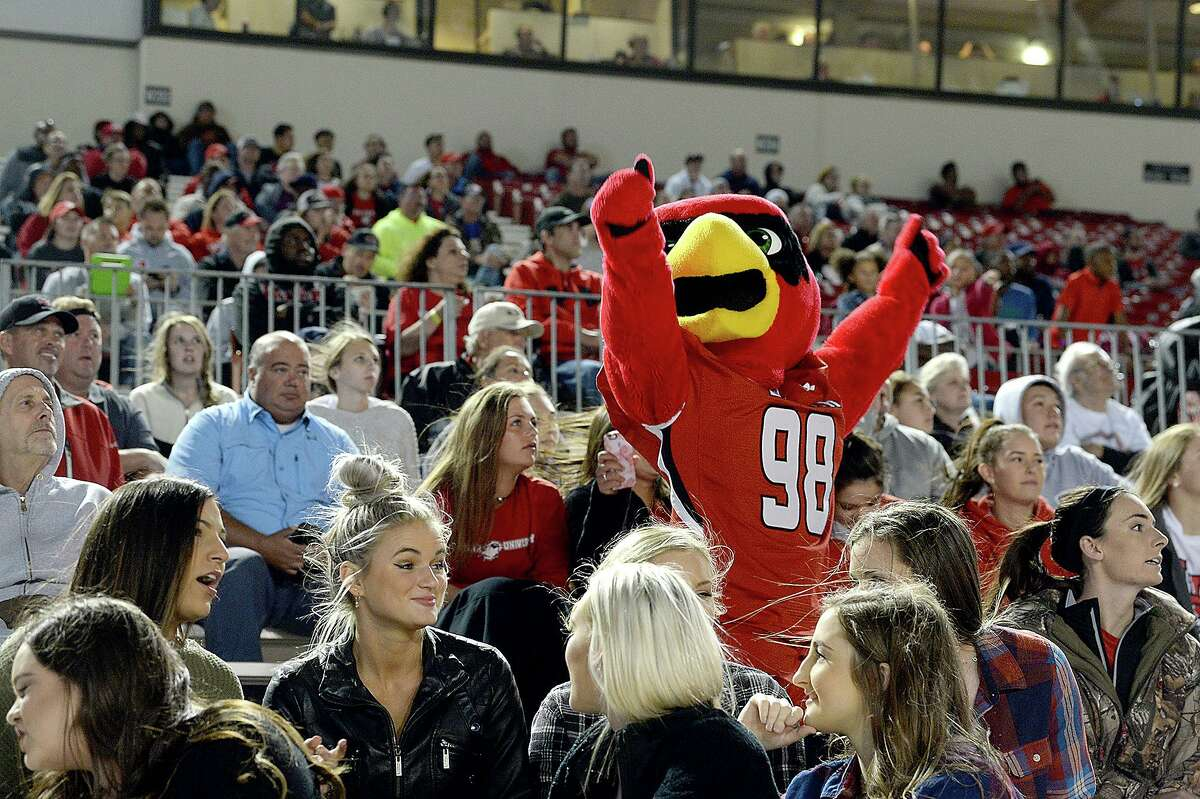 Lamar's fans react as Big Red works the crowd during the first quarter action with rival McNeese State during the Cardinals' final home game at Provost Umphrey Stadium Saturday. Photo taken Saturday, November 18, 2017 Kim Brent/The Enterprise