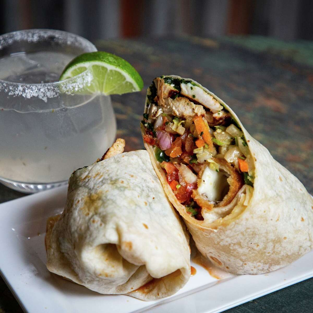 Lunch and dinner at TJ's Burritos is Mexican influenced, with burritos, tacos, salads, bowls and a variety of sandwiches and burgers.