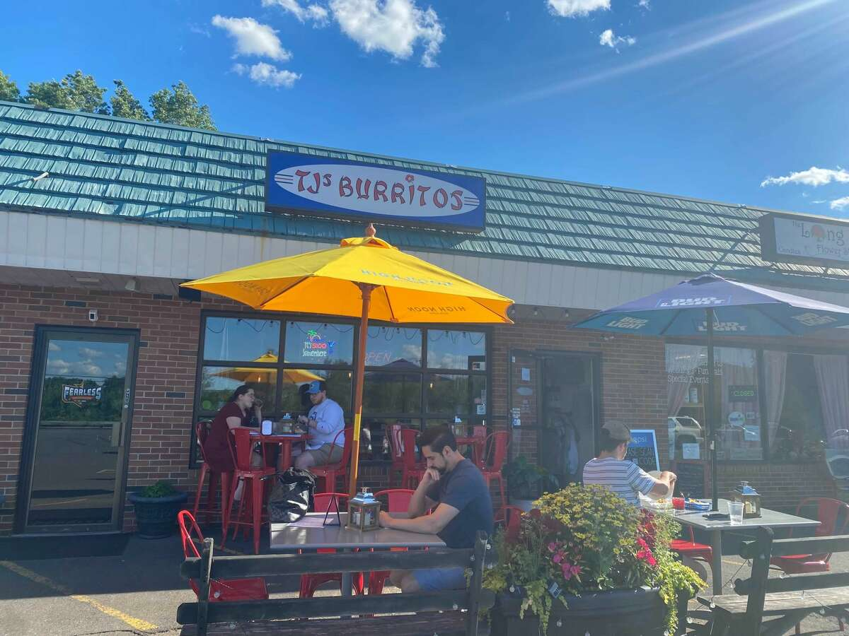 TJ's outdoor seating offers umbrella-shaded tables and colorful planters.