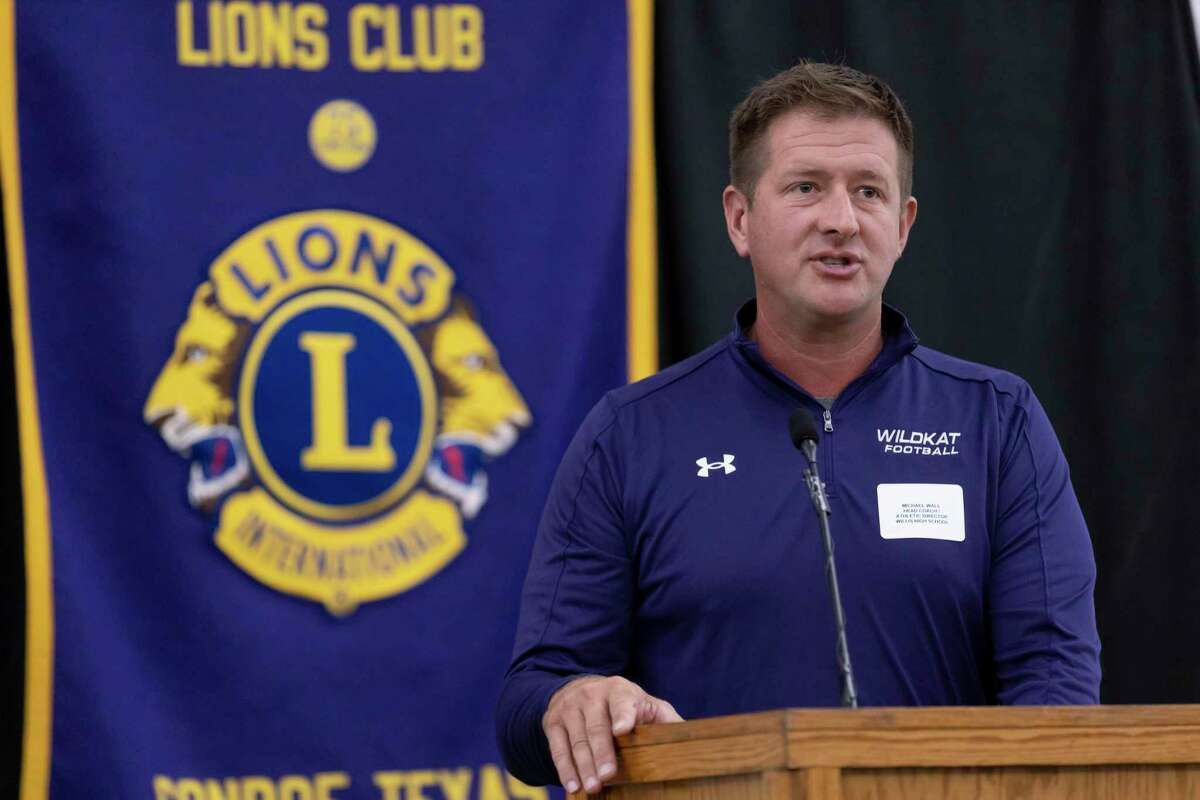 Willis High School head football coach Michael Wall speaks during the 45th annual Conroe Noon Lions Club Pigskin Preview at the Lone Star Convention Center, Wednesday, August 4, 2021, in Conroe.