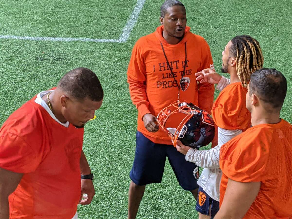 Albany Empire defensive coordinator Sergio Gilliam, second from left, talks with defensive players, from left, Brandon Sesay, Nhyre Quinerley and Gabe Ostrow during practice Wednesday, Aug. 4, 2021. The Empire face the Carolina Cobras in a National Arena League semifinal playoff game Saturday at Times Union Center.