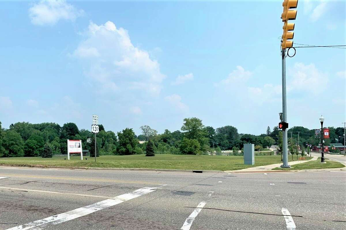 This parcel at the corner of North State Street and Baldwin Street in Big Rapids, formerly known as the Hanchett property, is being marketed to developers for possible residential and retail space. A potential developer has shown interest in the property recently. (Pioneer photo/Cathie Crew)