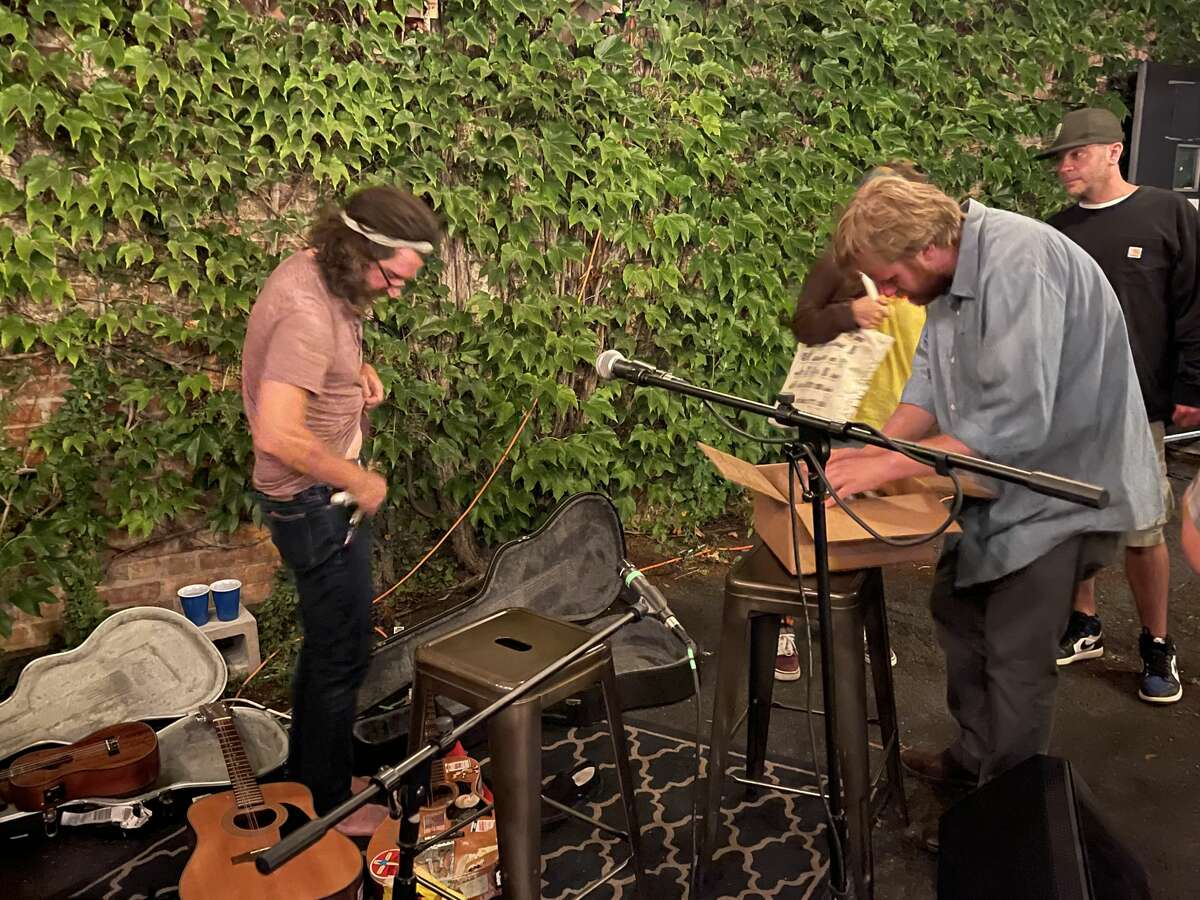 Following his set at Rare Form Brewing in Troy on Tuesday, Aug. 3, 2021, Lou Barlow invited the crowd of roughly 60 people dig through his selection of vinyl records.