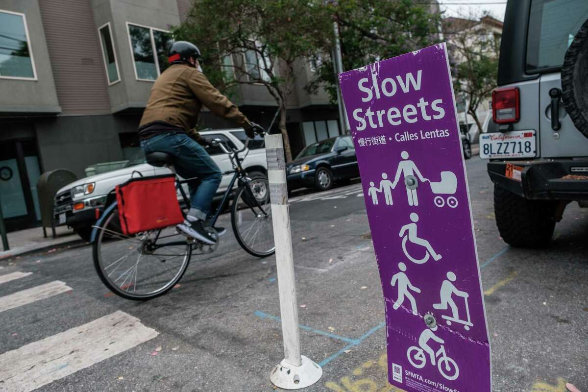 A bicyclist is seen riding down Shotwell Street in San Francisco on Wednesday. The area of Shotwell Street in the Mission District between 14th Street and Cesar Chavez Street has been approved by the city as a permanent Slow Street.