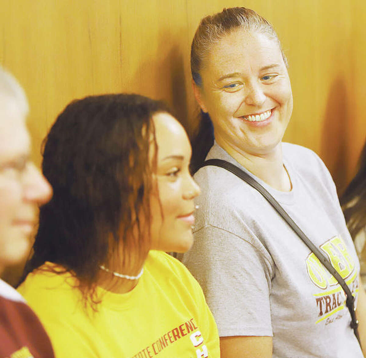 Jayden Ulrich's mother, Jeniffer, right, beams with pride as her daughter's accomplishments are read in a proclamation at the East Alton Village Board meeting Tuesday night.