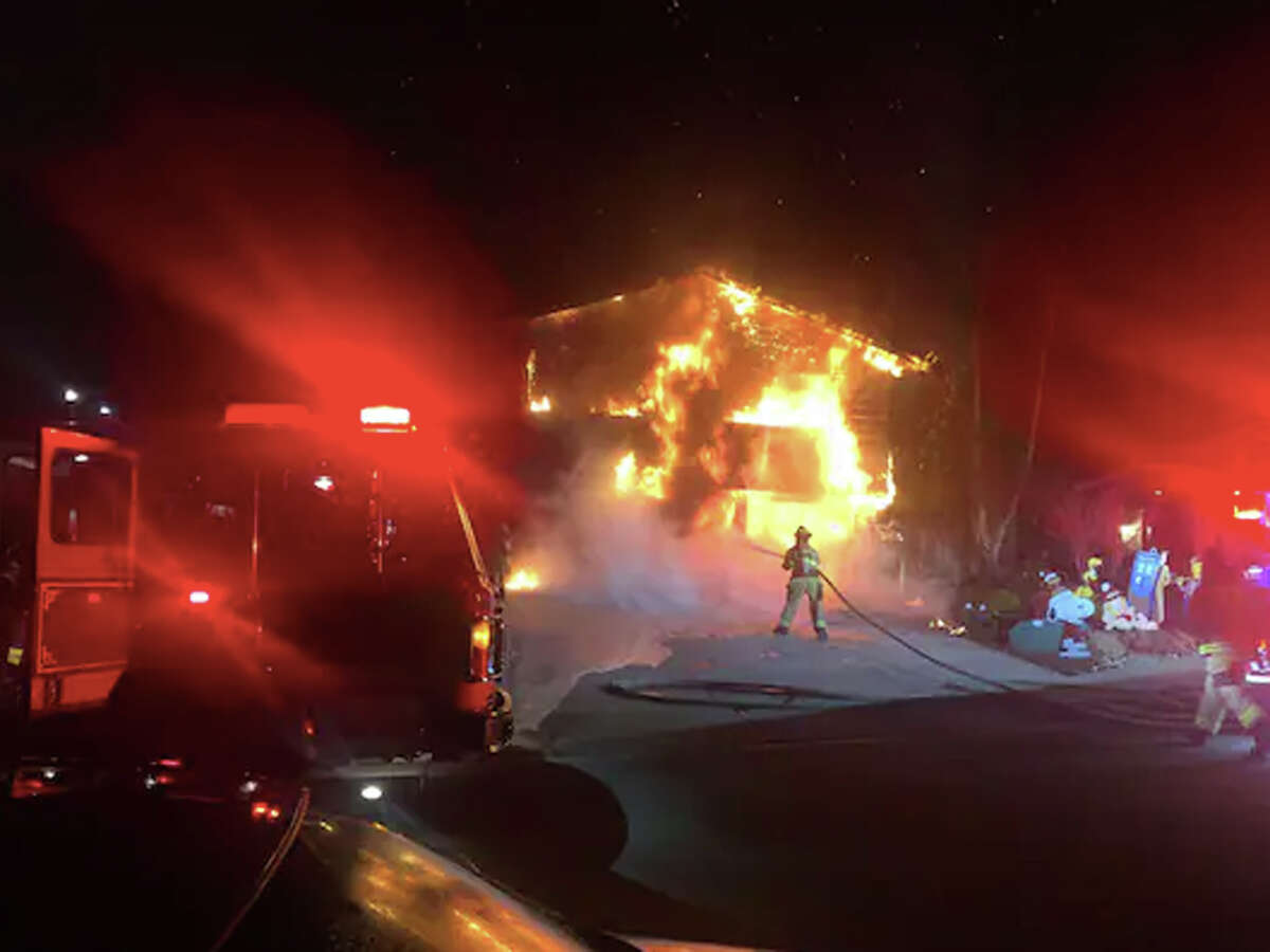 The home of Yogi and Carolyn Vindum in San Ramon, Calif., burns on the morning of Dec. 30 after two Tesla Model S sedans erupted in flames in the garage.