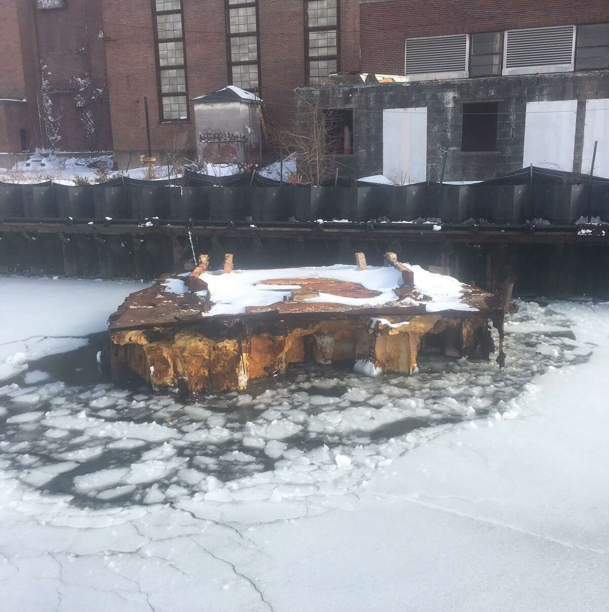 An abandoned barge tied to English Station power plant at Ball Island on the Mill River, photographed in January 2021.