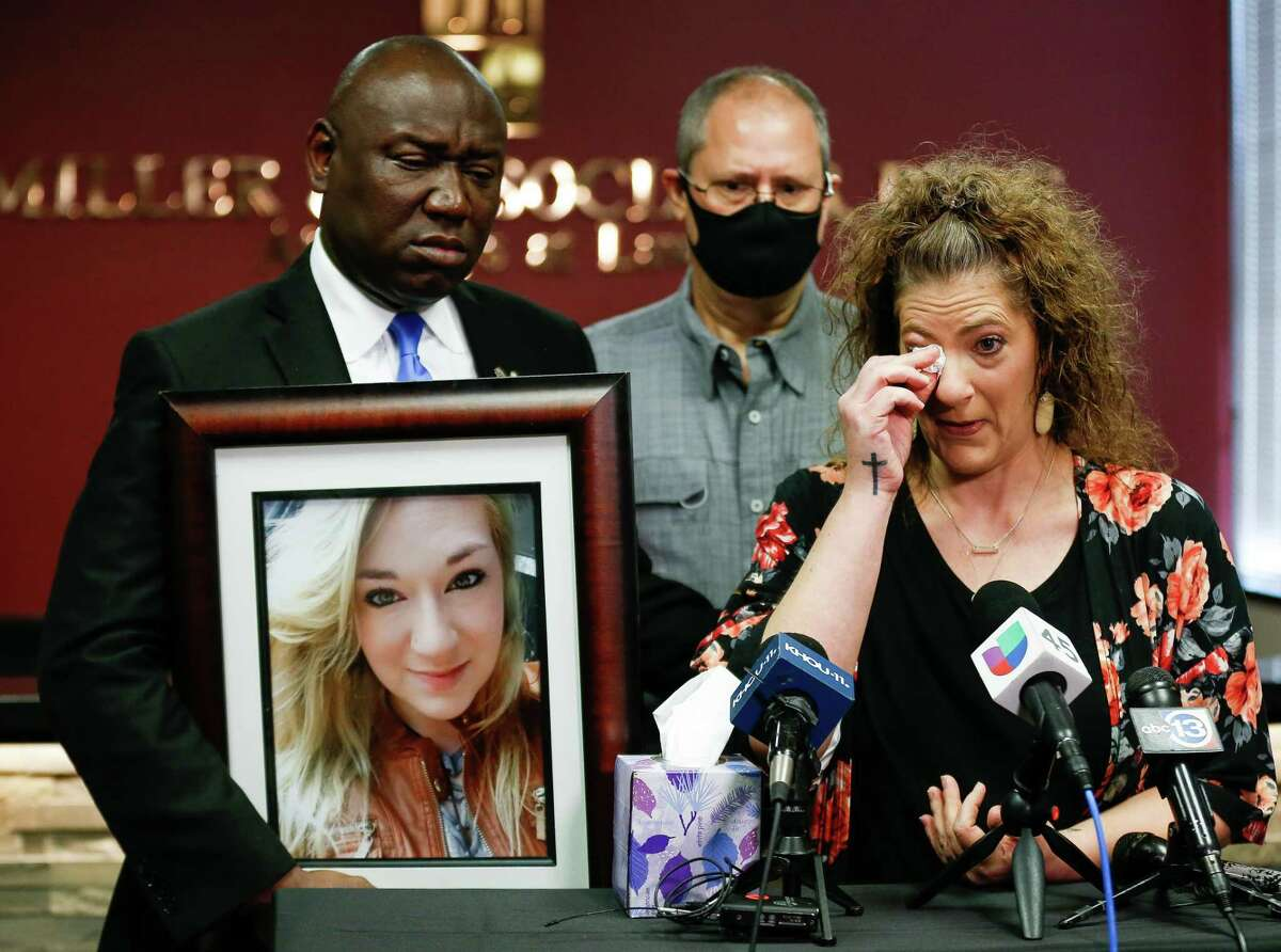 Melanie Infinger wiped off tears from her eyes as she talked about the death of her daughter Caitlynne Infinger Guajardo - whose family was murdered by her husband while he was out on multiple personal recognizance bonds in 2019 - during a press conference where attorney Ben Crump announced a lawsuit against Harris County on Wednesday, Aug. 4, 2021, in Houston.