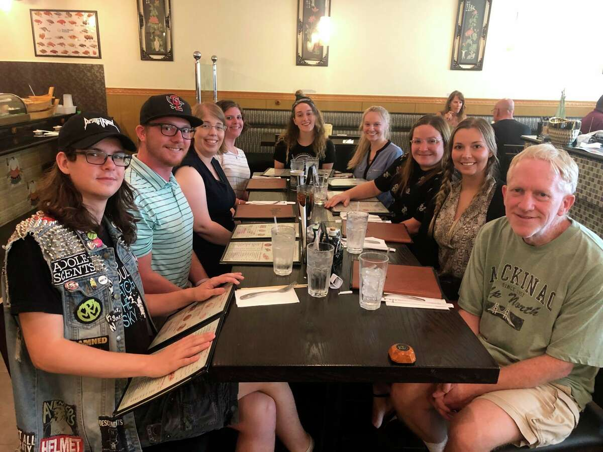 The Midland Daily News crew is pictured with Aurora Abraham (seated at the head of the table) at Fuji Sushi in Midland. The crew was celebrating Abraham's internship, which is coming to an end this week.