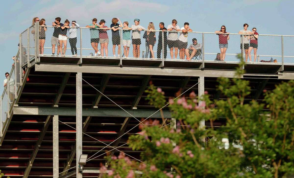 With COVID-19 vaccinations rolling out, Magnolia ISD Athletic Director JD Berna shared his thoughts about the upcoming 2021-22 athletics season. Fans watch from atop the school's football stadium after the stands at Magnolia High School's softball field are full during a one-game Region III-5A quarterfinal game, Friday, May 14, 2021, in Magnolia.