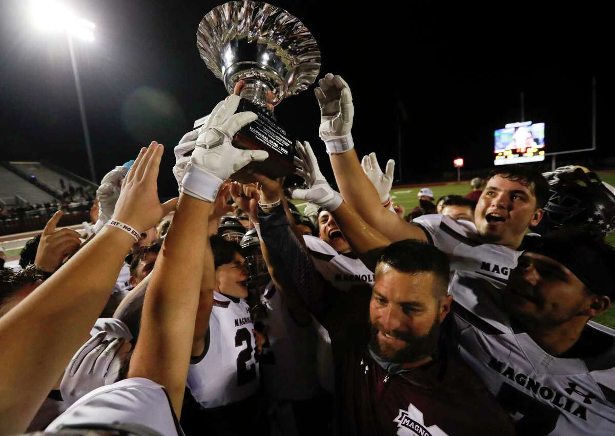 With COVID-19 vaccinations rolling out, Magnolia ISD Athletic Director JD Berna shared his thoughts about the upcoming 2021-22 athletics season. Magnolia head coach Craig Martin celebrates with the team after defeating rival Magnolia West 21-14 in the annual Magnolia Bowl at Magnolia West High School, Friday, Nov. 13, 2020, in Magnolia.