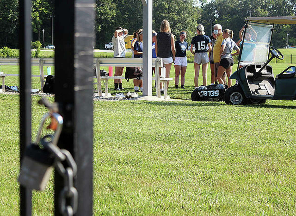 The padlock on the Tim Rooney Stadium gate is unlocked for the LCCC women's soccer team's first preseason practice of the season Wednesday morning.