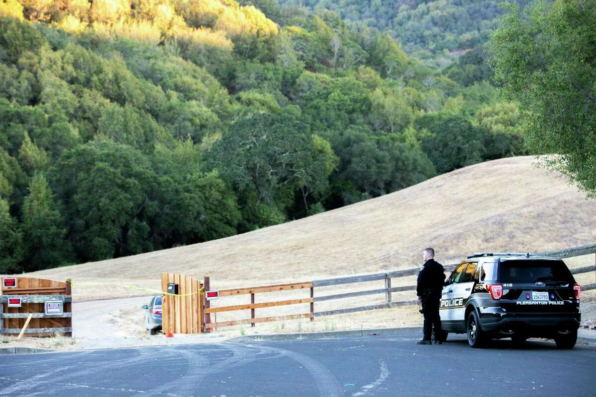 Police officials block the road at the end of Blessing Drive, which leads to Pleasanton Ridge, where authorities believe the body of Philip Kreycik was found. A smart watch recovered with the remains was undergoing analysis for clues about what happened to Kreycik, including a time of death.