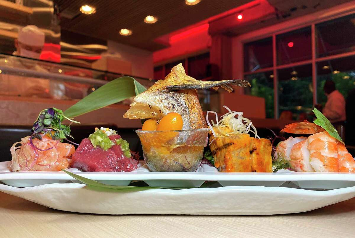 Sashimi tapas on a recent night at Shiro Japanese Bistro on the River Walk near the San Antonio Museum of Art included, from left, lomi salmon, akami and chutoro bluefin tuna, fried hamachi collar, barbecued miso albacore tuna and sous vide lobster and shrimp.