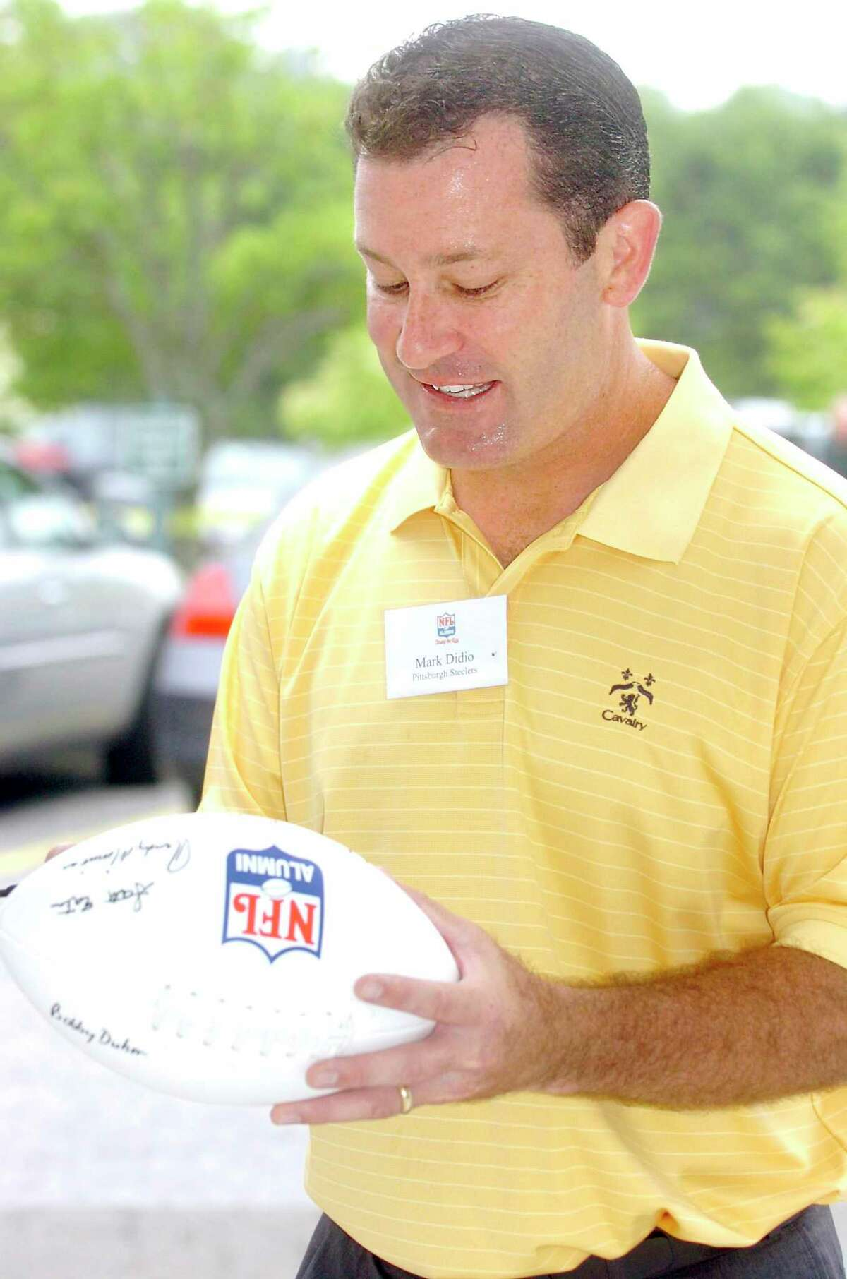 Darien_062308_Mark Didio, Pittsburgh Steelers, signs footballs at the NFL Alumni Charity Golf Tournament at the Country Club of Darien. Helen Neafsey/staff photo