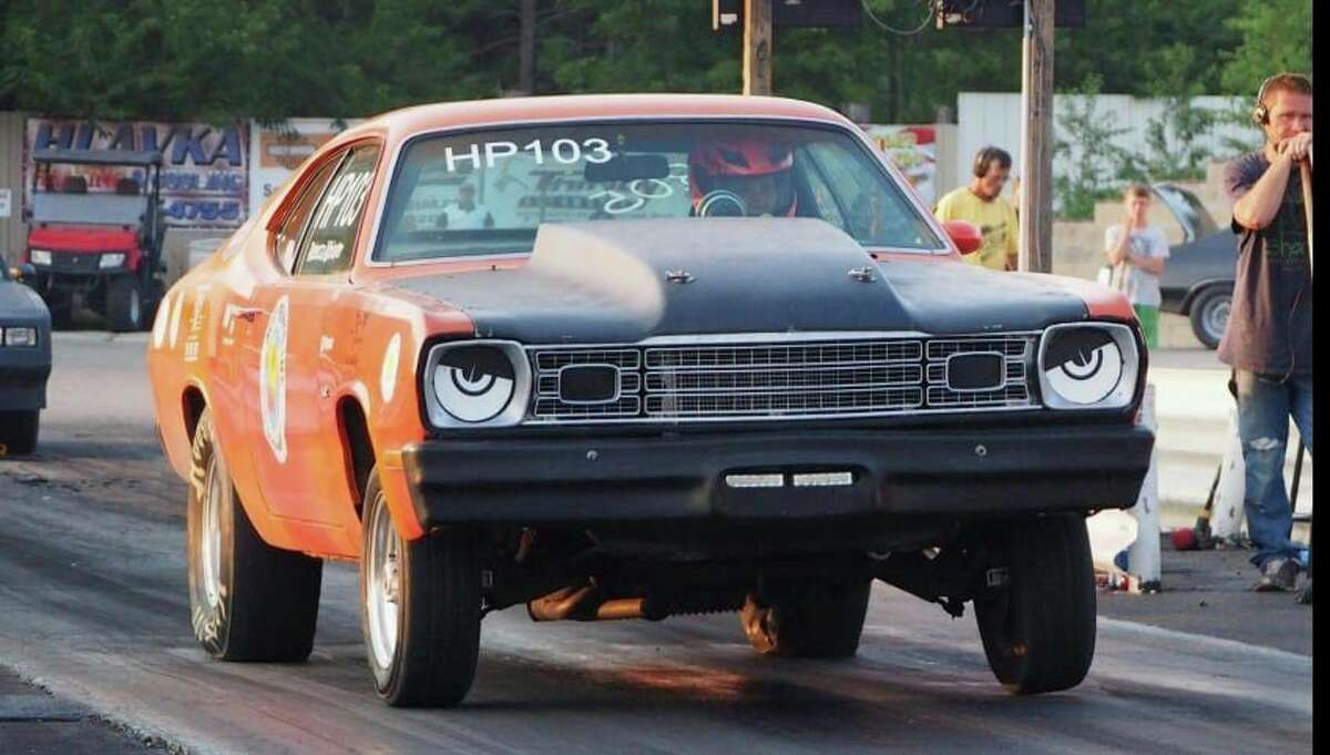 """Thursday night's seven-round Street Trophy winner, Rebecca Whitaker, of St. Johns, helped secure another convincing win by the Mopar racers atNorthern Michigan Dragway in Kaleva. Also finishing up in a 6th round quarter-final Saturday night in Pro Trophy, she raked in over 15 rounds won (points) with her """"Hot Prints"""" Plymouth Duster to help lead the 203-172 Mopar victory. (Courtesy photo)"""