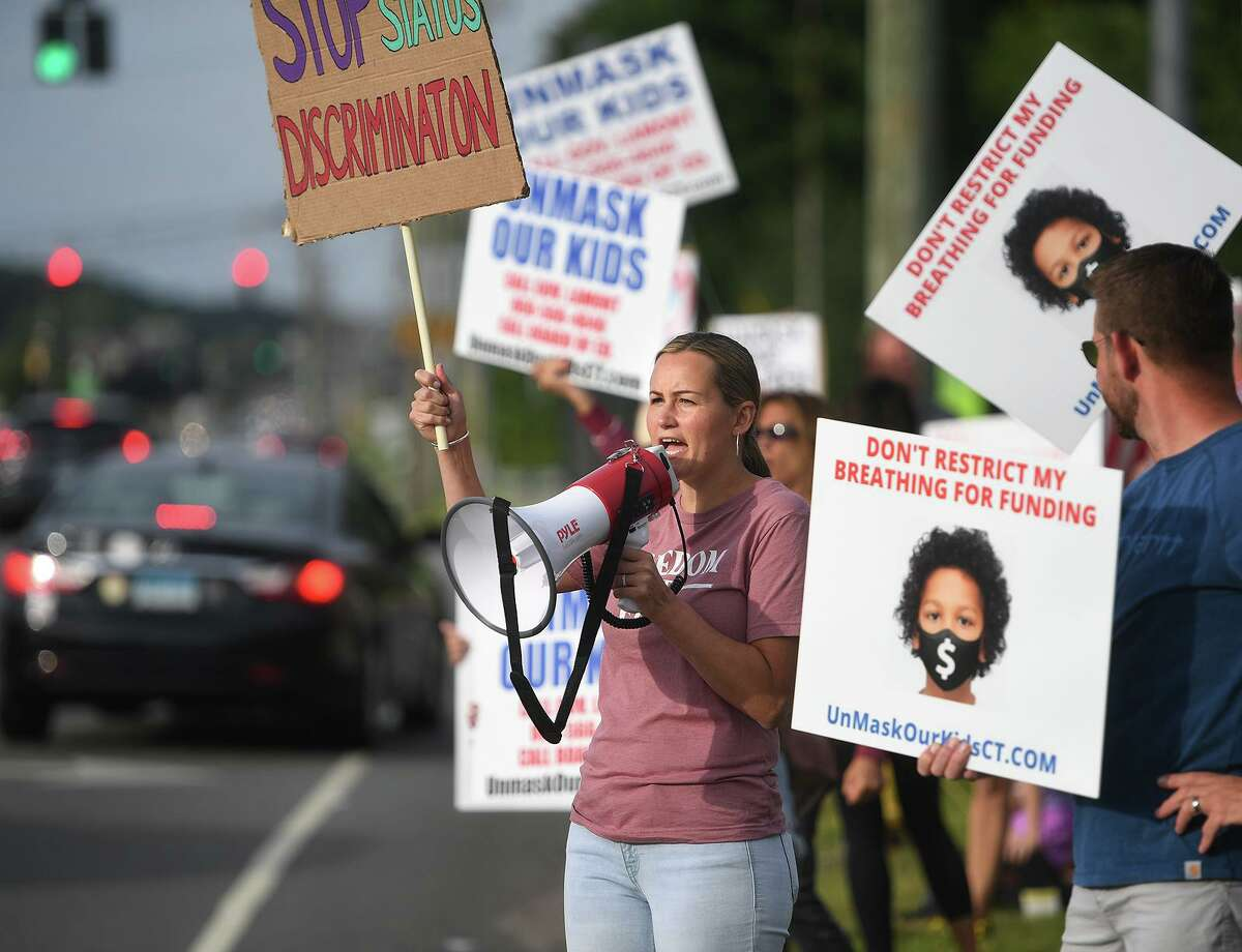 Board of Ed candidate Terri Smith, of Milford, participates in an Unmask Our Kids rally on the Post Road in Milford, Conn. on Tuesday, August 3, 2021. The rally was organized by the Facebook group's Milford chapter.