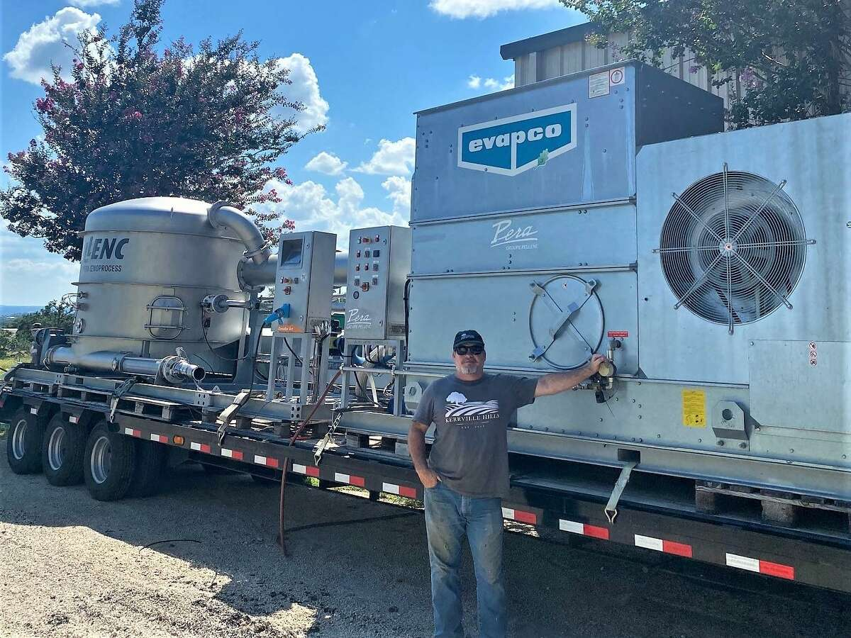 John Rivenbaugh with Kerrville Hills Winery stands in front of what is believe to be the FIRST flash détente extraction equipment on wheels in the Wine World. John will use this advanced technology to hopefully make more of his Platinum Medal wines using Texas grapes.