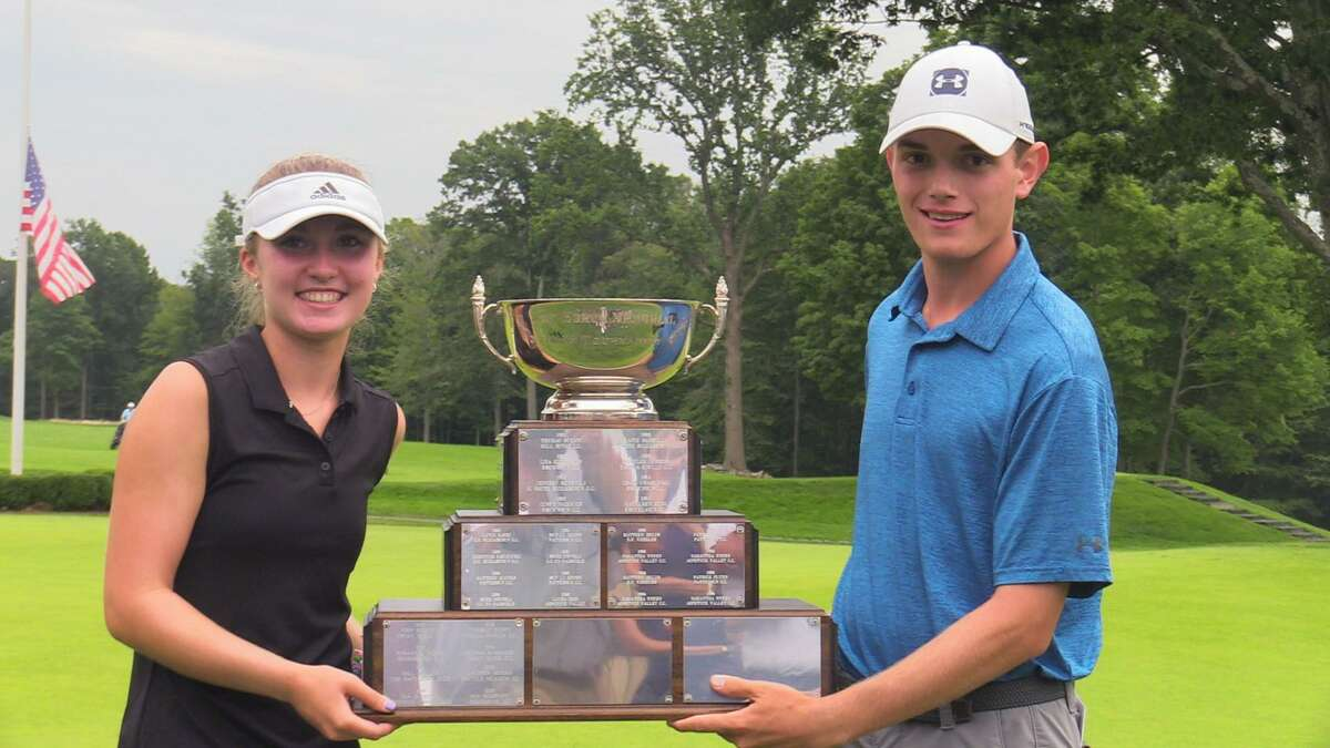Mia Holbrook, left, and Alex Elia hold the trophy and winning the 52nd Borck Junior golf tournament at Silver Spring Country Club in Ridgefield, Conn. on Wednesday, August 4, 2021.