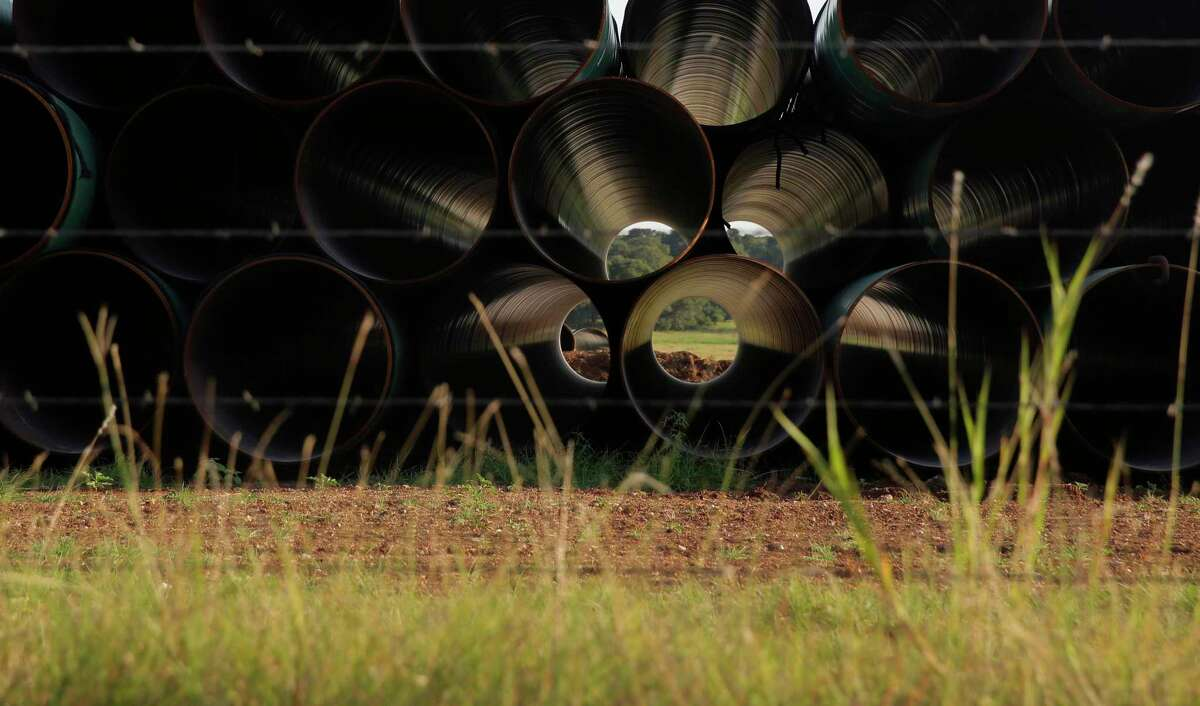 Pipes for a proposed new natural gas pipeline that would pass through the Texas Hill Country are staged near Blanco, Texas Friday, Aug. 2, 2019.