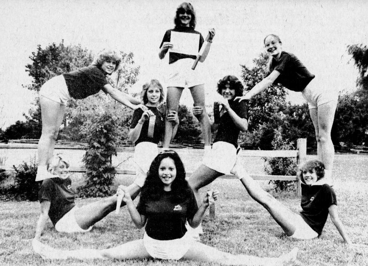 """Manistee High School varsity cheerleaders recently attended a camp sponsored by the National Cheerleading Association in Adrian and came away with a """"spirit stick"""" and ribbons for superior spirit performance displayed by the squad. Shown above in winning form are Sarah Loredo (front), along with (second row, left to right) Deanne Jones, Merri Majchrzak, Jill Yonkman, Lisa Walters; and in back (left to right) are Debbie Wiser, Amy Kolanowski and Jodi Radlicki. The photo was published in the News Advocate on Aug. 6, 1981. (Manistee County Historical Museum photo)"""