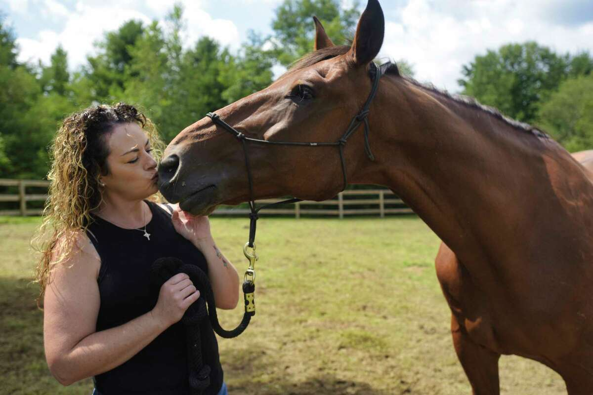 Nurse Deirdre Maloney at her home with Sloan, her horse, on Wednesday, July 28, 2021, in Pattersonville, N.Y. (Paul Buckowski/Times Union)