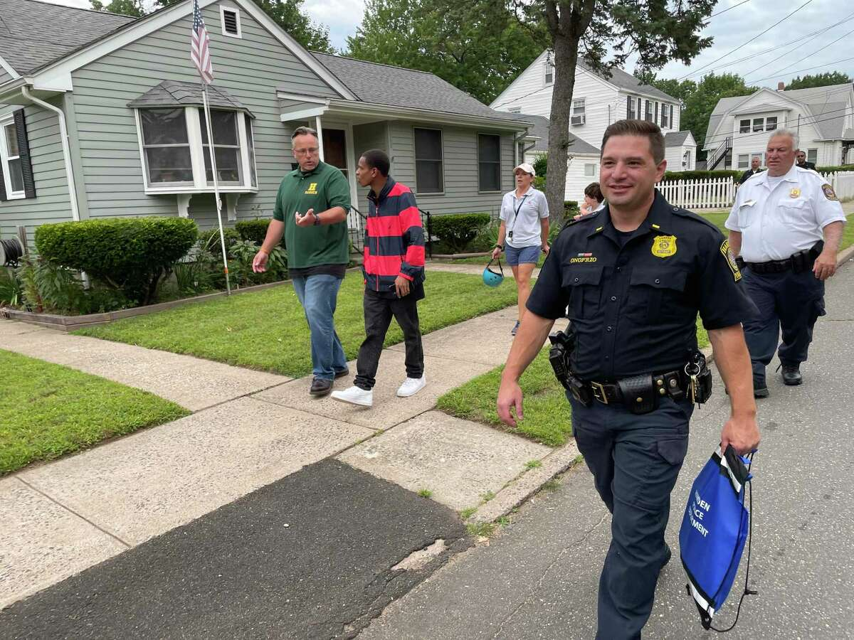 Hamden police Lt. William Onofrio, who heads the department's Neighborhood Initiatives Unit, on a community walk Aug. 4, 2021. At left are Mayor Curt Balzano Leng, left, and event organizer Daniel Hunt.