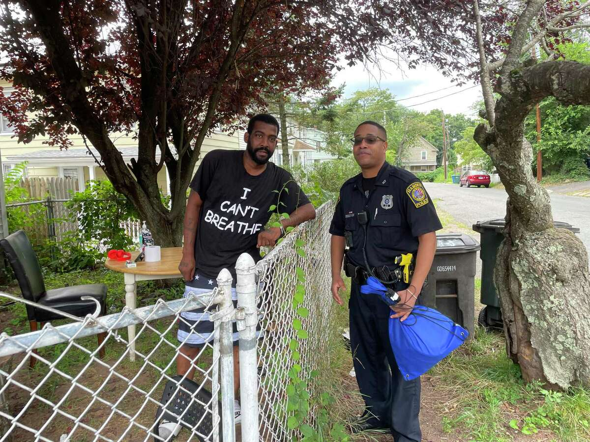 Hamden police Officer Chris Sheppard stops to talk with resident Ray Williams during the department's first community walk on Aug. 4, 2021.