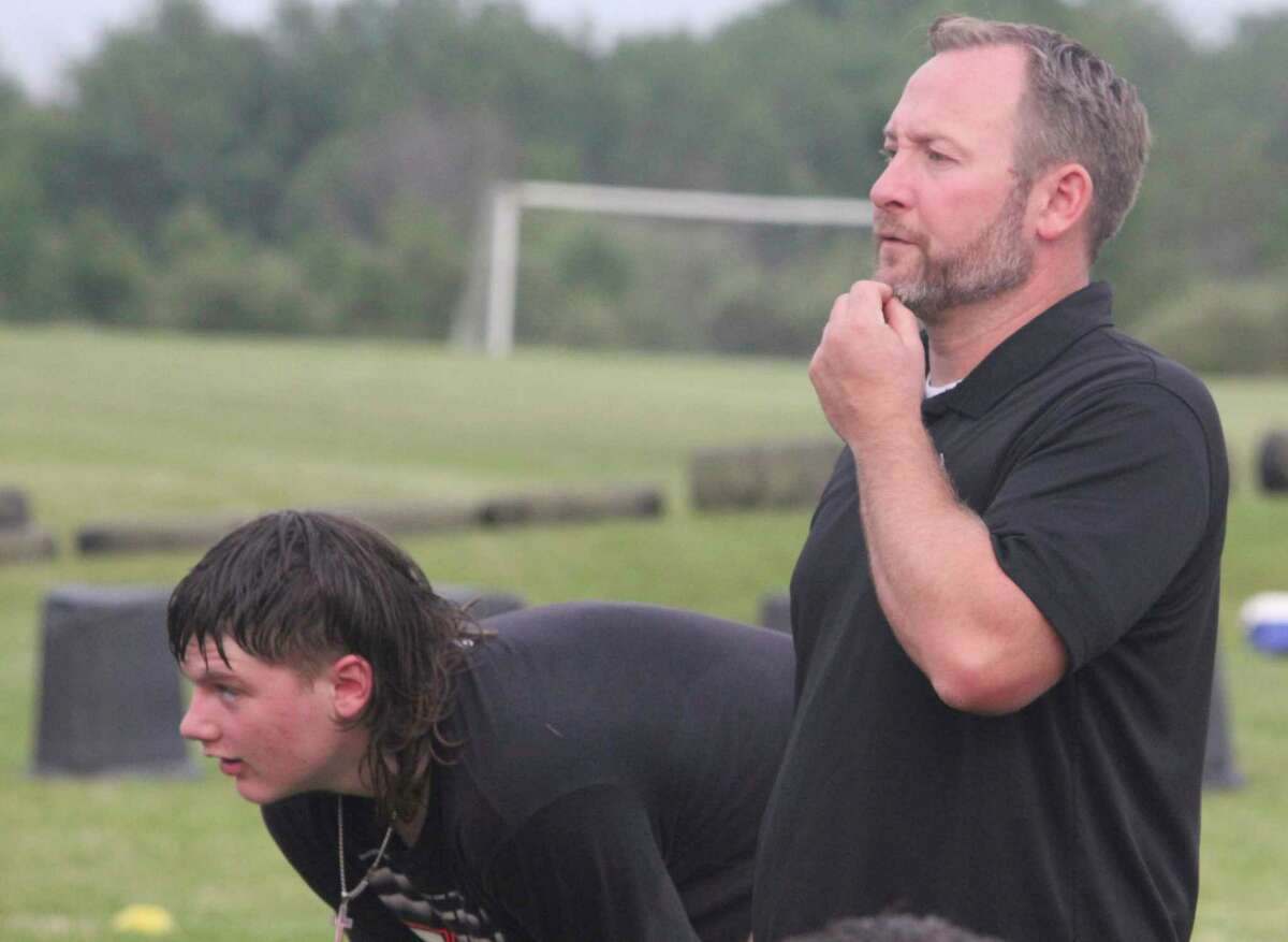 New Reed City athletic director Ryan Hansen (right)watches the action during a Coyote summer practice last week. (Pioneer photo/John Raffel)