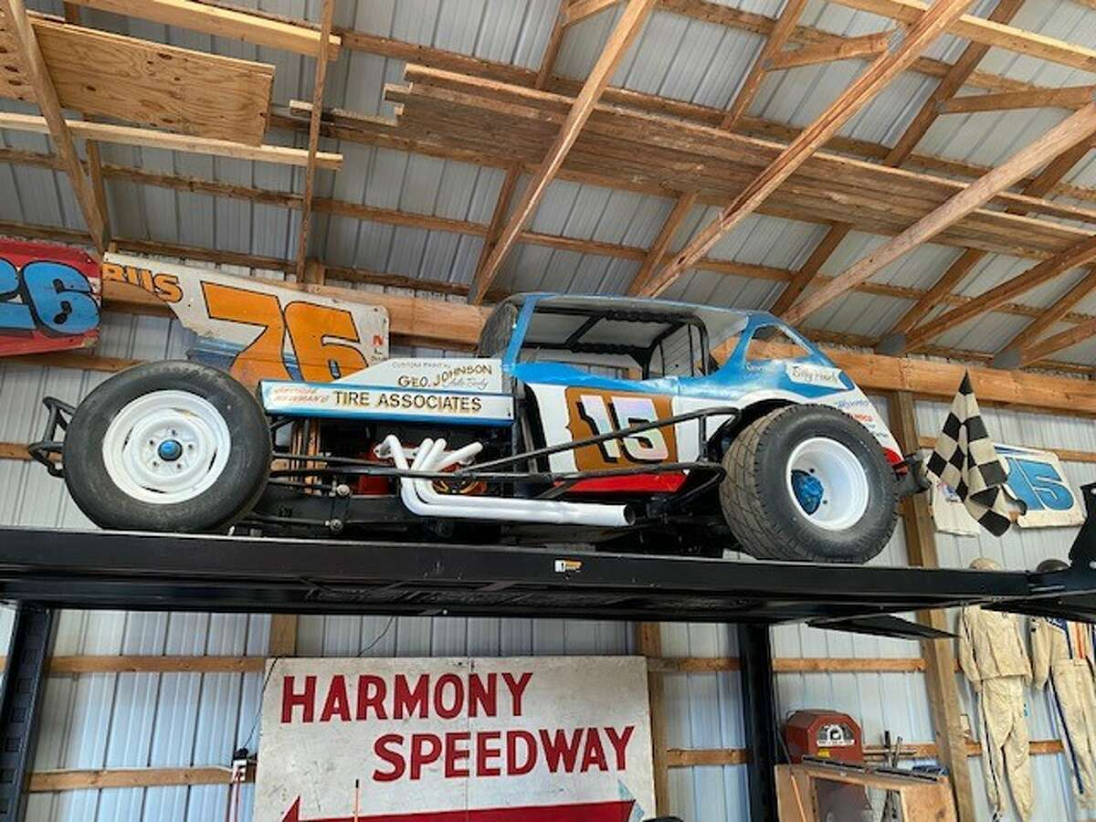 A race car and signage, part of driver Bill Pauch's collection at his open house.