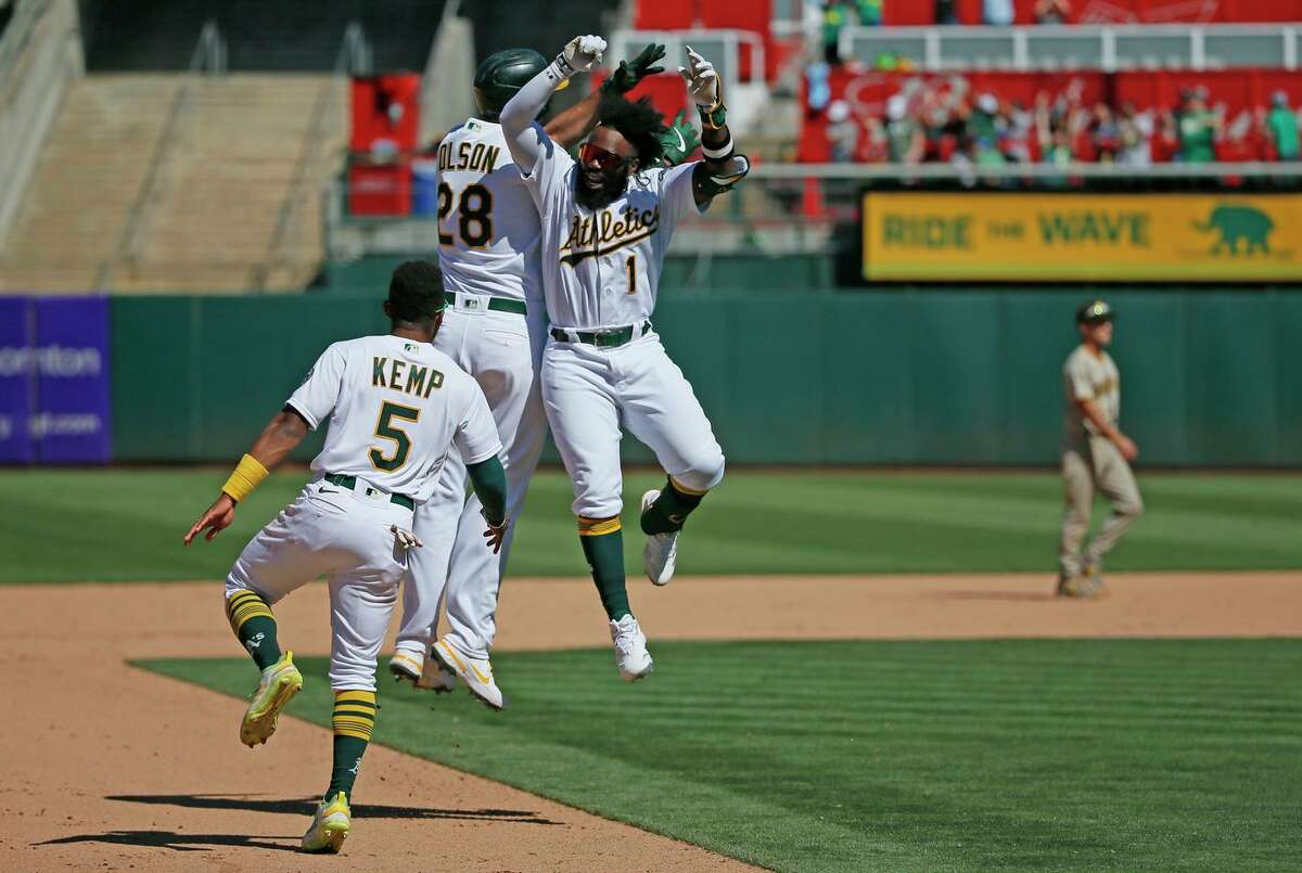 Oakland Athletics Matt Olson (28) celebrates his walk-off hit to win the MLB game against the San Diego Padres in the tenth inning at RingCentral Coliseum on Wednesday, Aug. 4, 2021, in Oakland, Calif. The Athletics won 5-4.