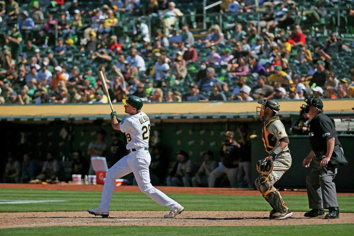 Oakland Athletics Matt Olson (28) watches his walk-off hit to win the MLB game against the San Diego Padres in the tenth inning at RingCentral Coliseum on Wednesday, Aug. 4, 2021, in Oakland, Calif. The Athletics won 5-4.