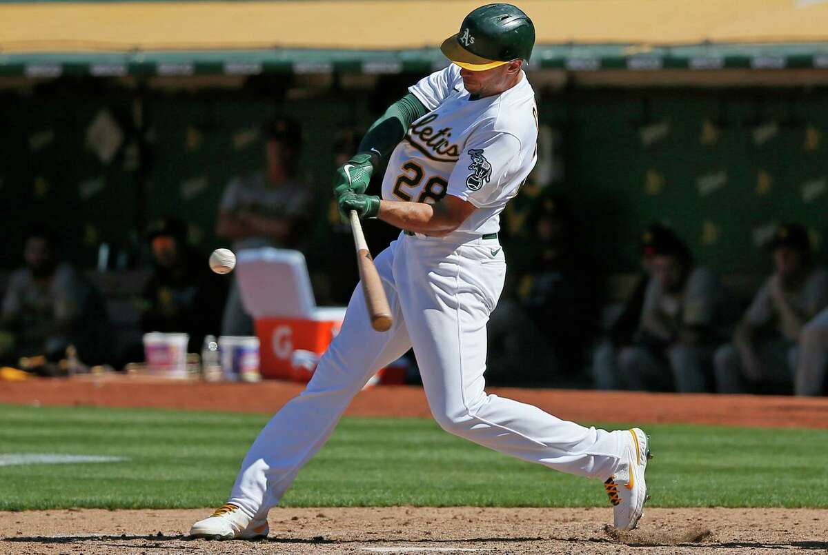 Matt Olson hits a first-pitch fastball for a walk-off double against reliever Tim Hill of the Padres. The A's won 5-4. Oakland did little damage over the first eight before breaking out.