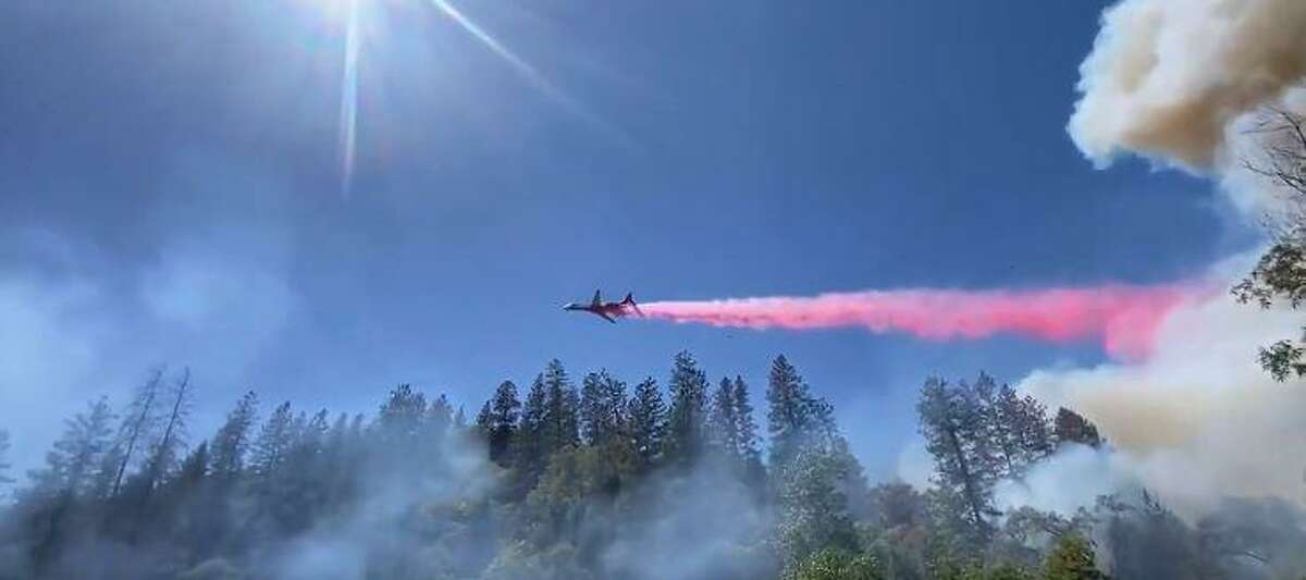 A plane drops fire retardant on the River Fire on Aug. 4, 2021.