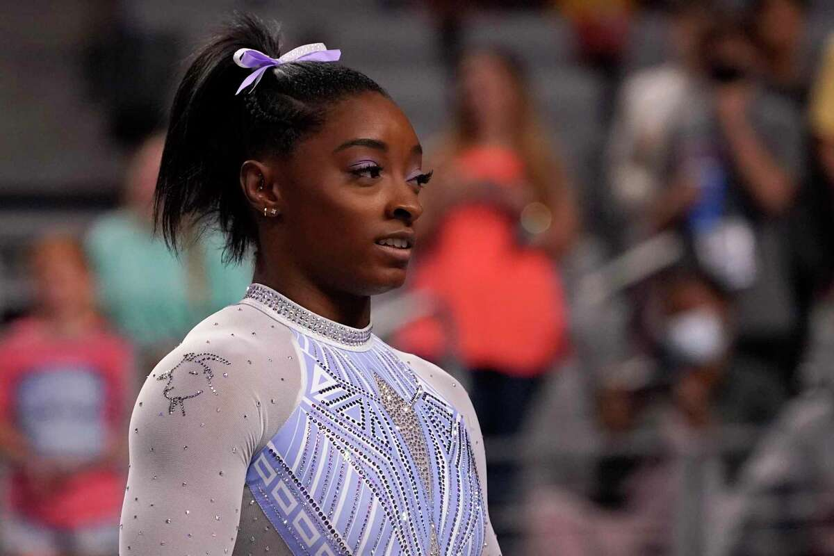 Simone Biles waits her turn to compete on the balance beam during the U.S. Gymnastics Championships in Fort Worth, Texas, June 4, 2021. Biles wore a goat laced into her leotard during the competition.