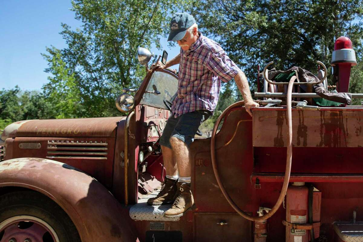 Randy Dunn, of Dunn Vineyards in Angwin, hops out of a 1946 fire truck he bought to protect his winery from wildfires. Dunn has been trying to bolster firefighting efforts in Napa Valley.