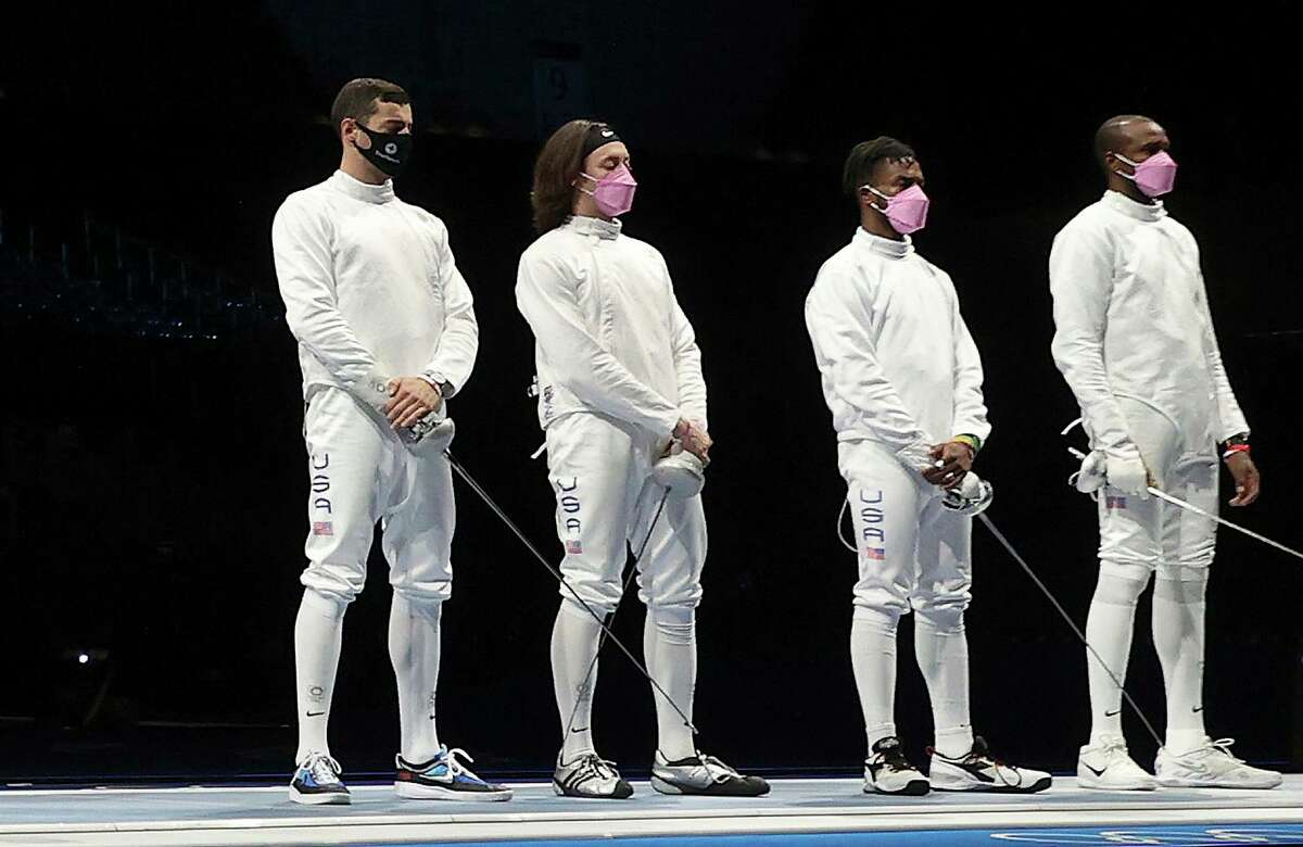CHIBA, JAPAN - JULY 30: Team United States stands on the piste before their Men's Team Epee match against Japan on day seven of the Tokyo 2020 Olympic Games at Makuhari Messe Hall on July 30, 2021 in Chiba, Japan. (Photo by Elsa/Getty Images)