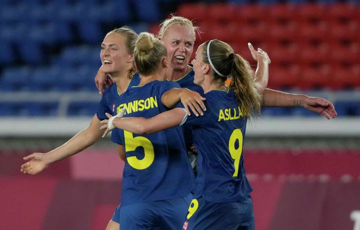 Sweden's players celebrate their 1-0 victory over Australia during their women's semifinal soccer match on Monday.