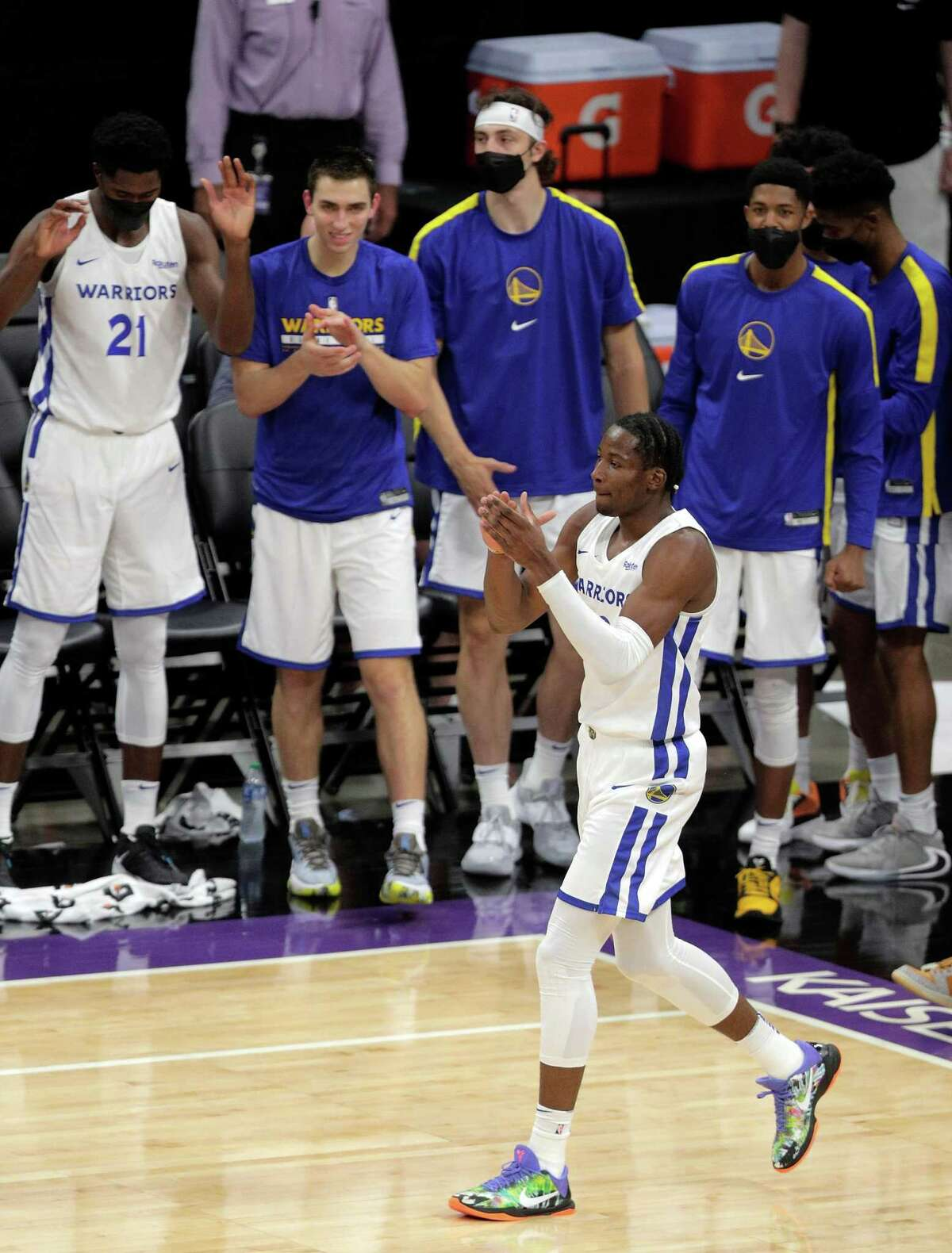 Jonathan Kuminga (00) celebrates after a dunk in the first half as the Golden State Warriors summer league played the Miami Heat Summer league in the 2021 California Classic at Golden 1 Center in Sacramento, Calif., on Wednesday, August 4, 2021.