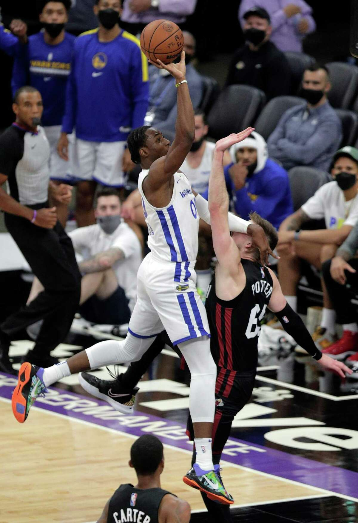 Jonathan Kuminga (00) puts a shot up over Micah Potter (65) in the first half as the Golden State Warriors summer league played the Miami Heat Summer league in the 2021 California Classic at Golden 1 Center in Sacramento, Calif., on Wednesday, August 4, 2021.