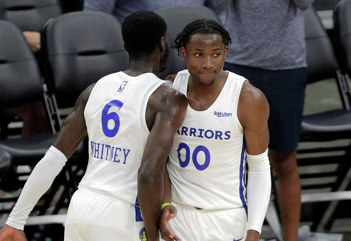 Jonathan Kuminga (00) celebrates with Kahlil Whitney (6) after a dunk in the first half as the Golden State Warriors summer league played the Miami Heat Summer league in the 2021 California Classic at Golden 1 Center in Sacramento, Calif., on Wednesday, August 4, 2021.
